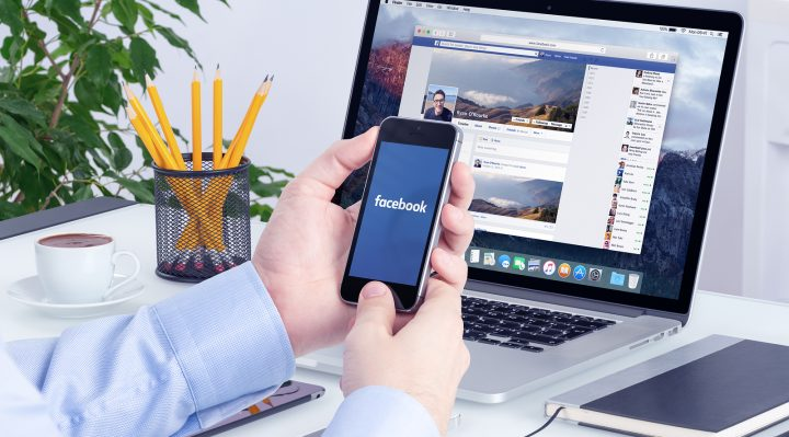Facebook app on the Apple iPhone display and desktop version of Facebook on the Apple Macbook Pro Retina. Multi devices multitasking concept. All gadgets in full focus. Varna Bulgaria - May 29 2015.