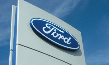Ford Motor Company (NYSE:F) Details System for Converting Rear Car Wheel to Electric Unicycle